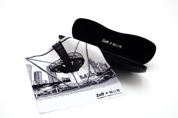 (写真3)Zoff(ゾフ) x 3月のライオン 桐山零コラボメガネには、羽海野チカ氏がデザイン監修したケースと、「3月のライオン」の舞台となっている「六月町」の原画がプリントされたメガネ拭きがついてくる。image by インターメスティック。